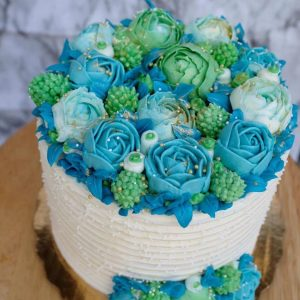 Blue and green rose birthday cake