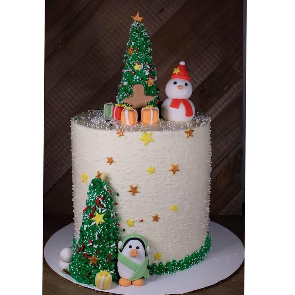 Christmas cake with snowman and penguin