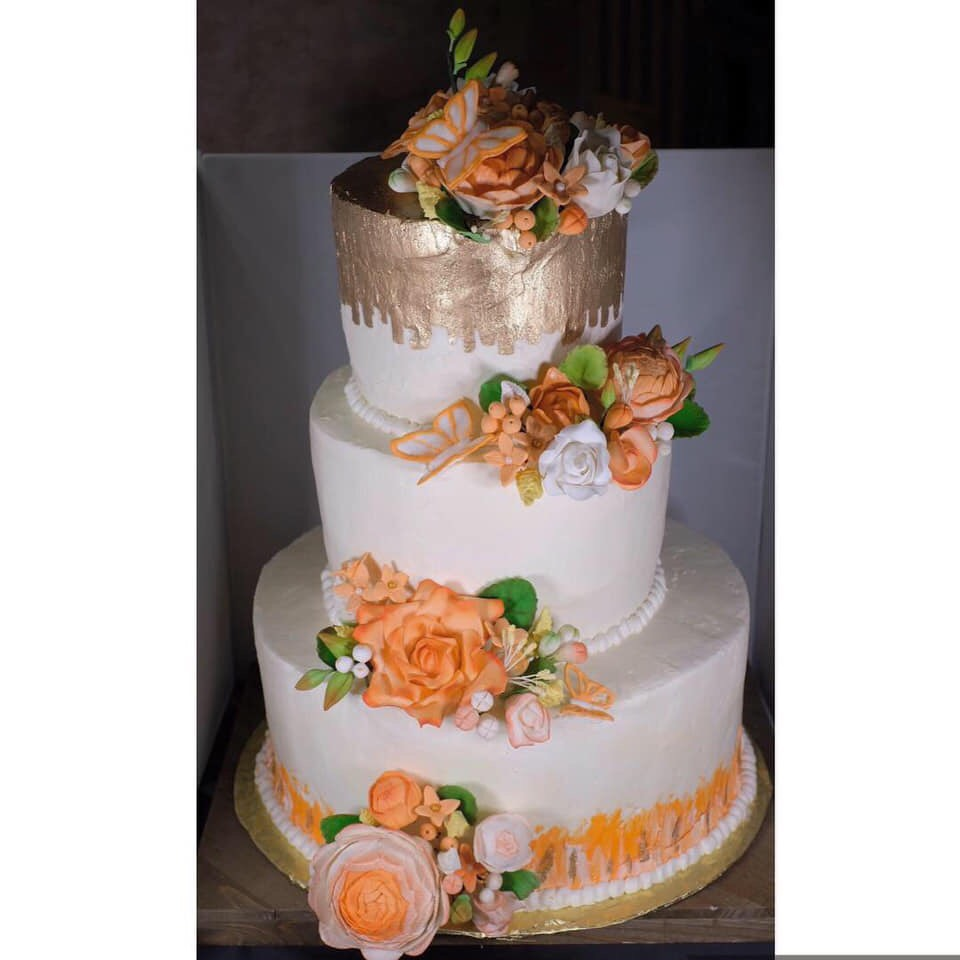 Peach roses and gold tiered cake