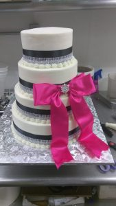 White and pink ribbon cake tiered