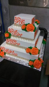 Orange and gold square tiered cake
