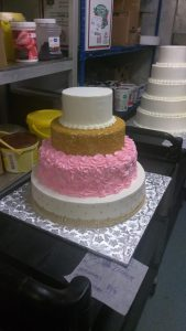 Pink gold and white tiered cake