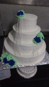 Pretty pearls and roses tiered cake