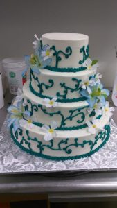 Green swirls and lilies tiered cake