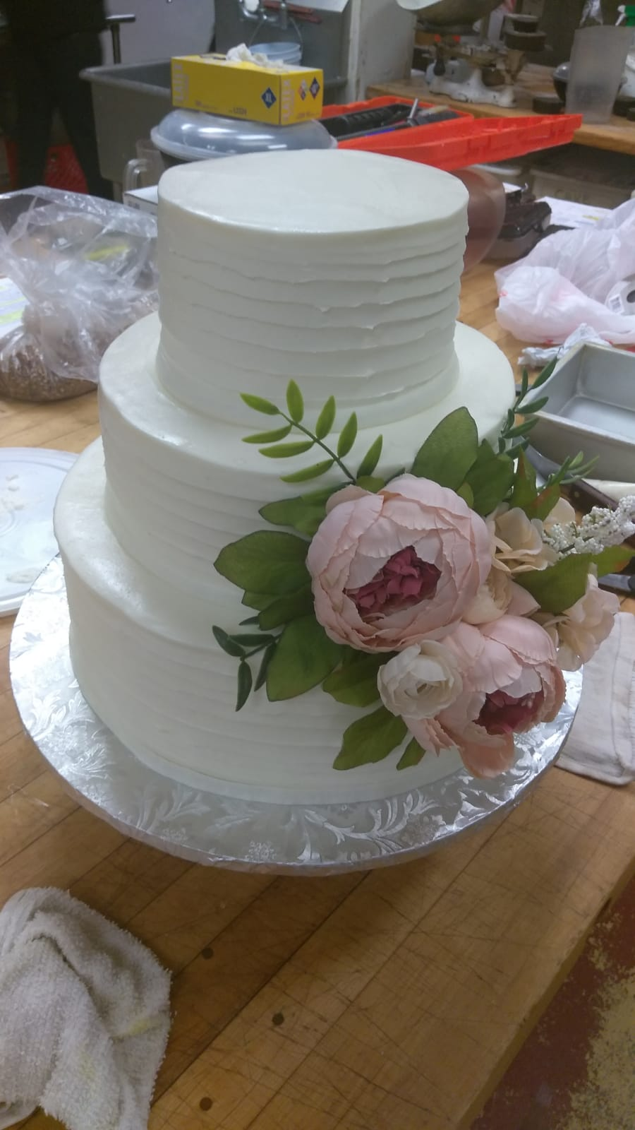 White tiered cake with peonies
