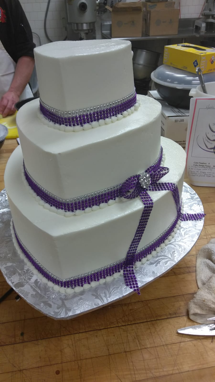 Purple ribbon and diamonds tiered heart cake