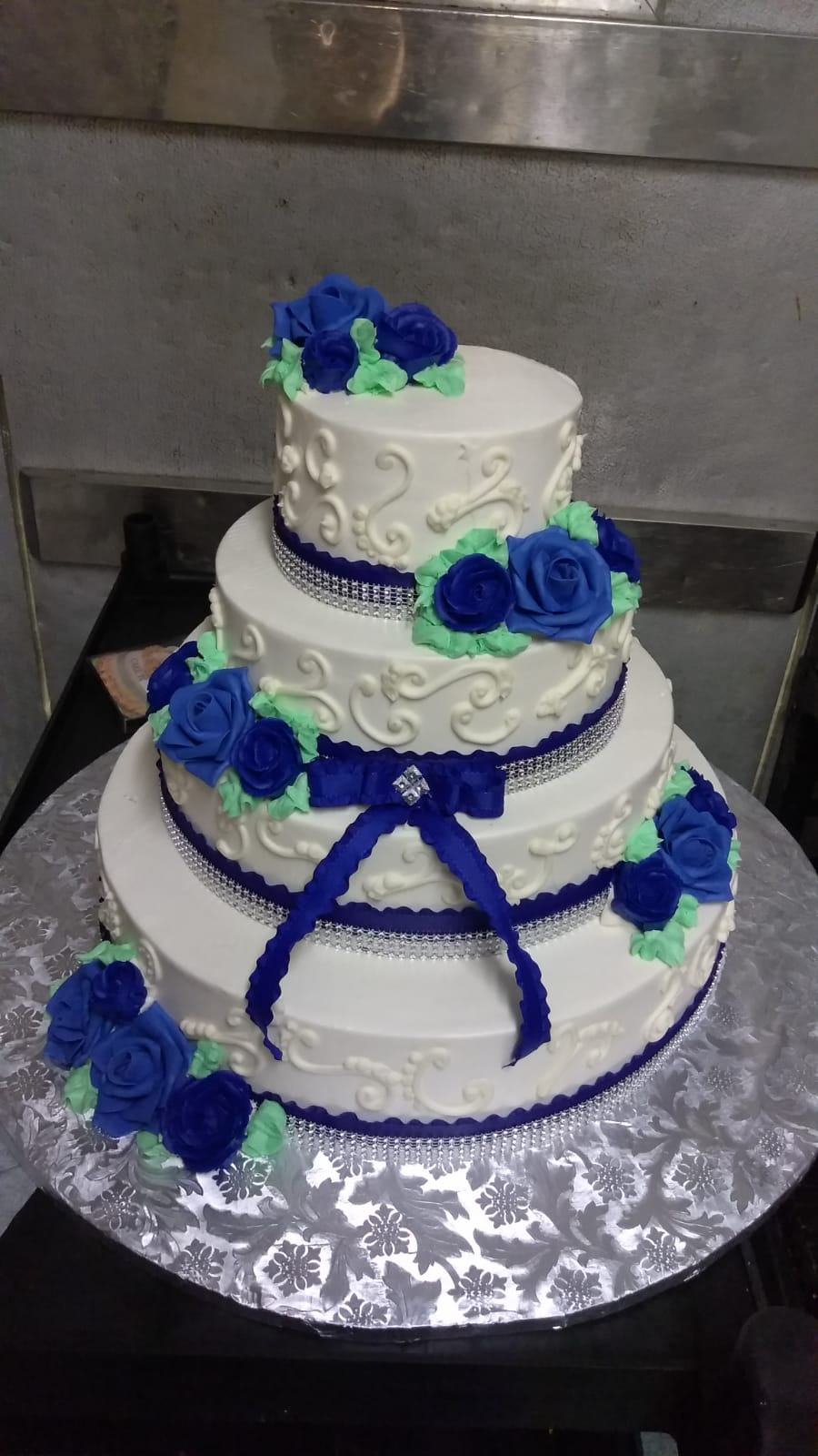Blue bow and flowers tiered cake