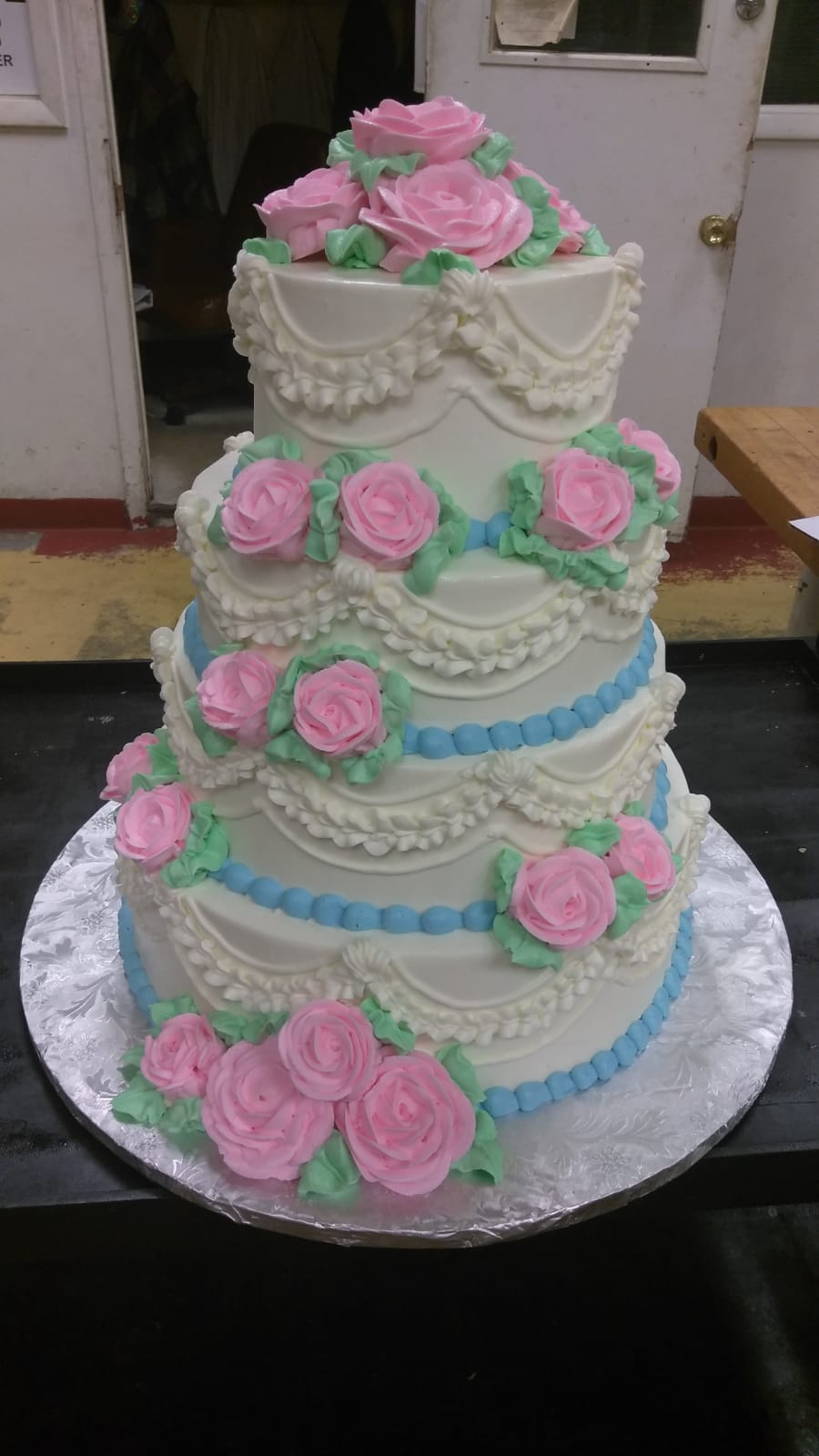 Pink and blue tiered cake