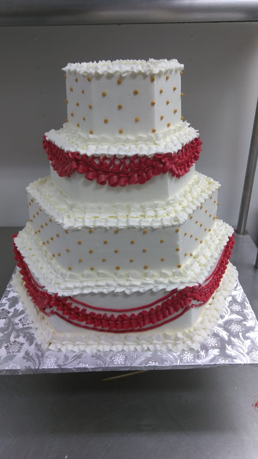 Red yellow and white tiered hexagon cake