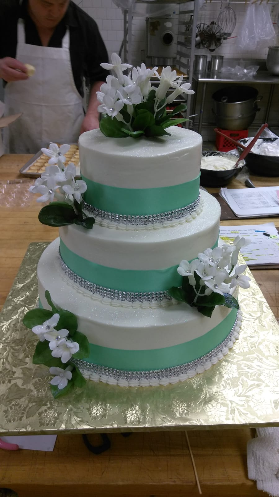 Teal satin ribbon and diamonds with flowers cake