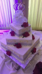Square diamonds and roses cake with heart topper