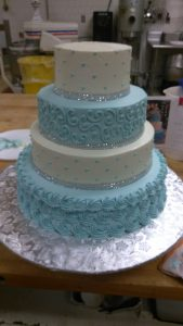 Blue and white polka dot cake