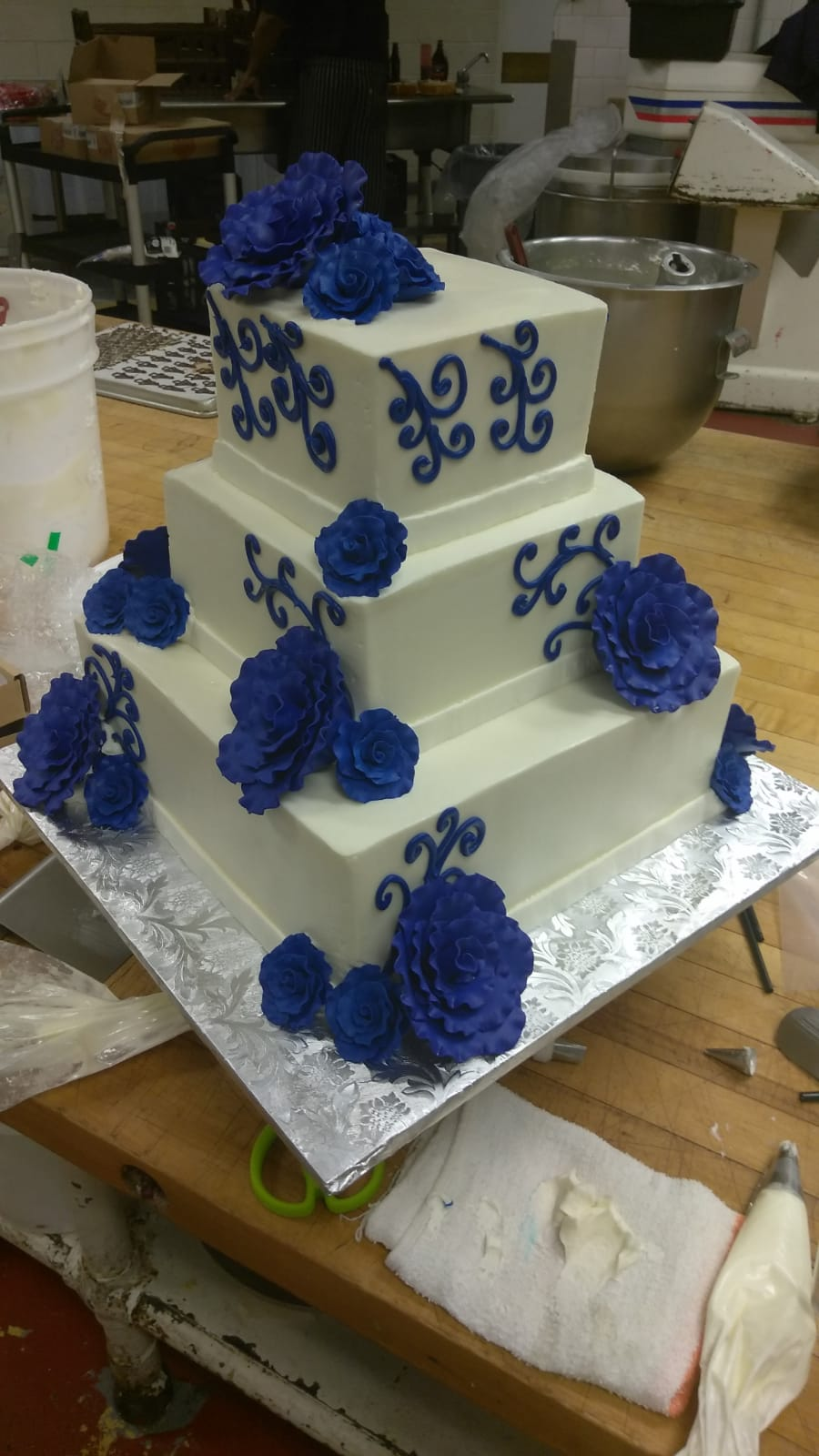Blue and white square wedding cake